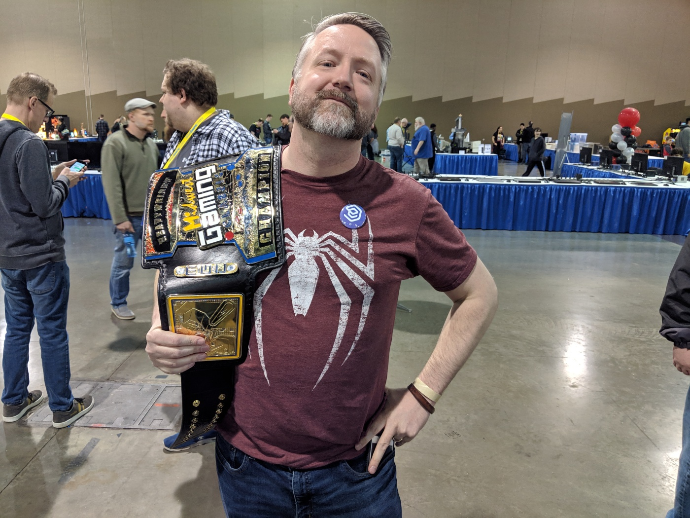 Tom with a championship belt