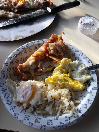 Breakfast was eggs, hashbrowns and pizza.
